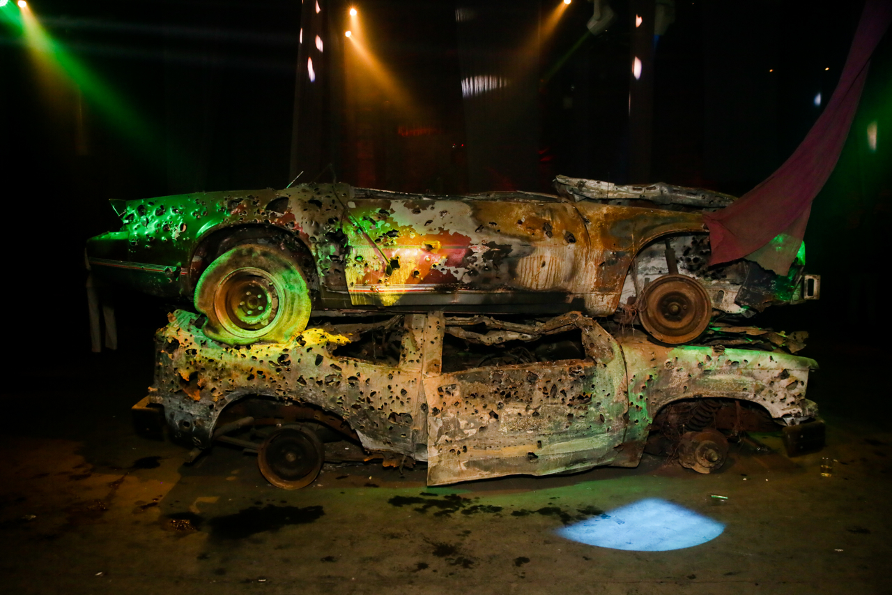 Bullet ridden cars at the Macabre Suite bacchanal. Photo courtesy Will Davis at Nadine Johnson.