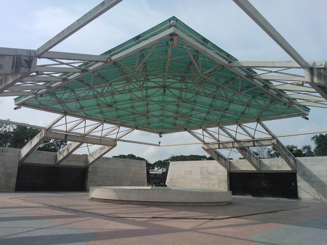 The Ziaur Rahman mausoleum alongside Bangladesh's parliament building (photo by Nahid Sultan, via Wikimedia Commons)