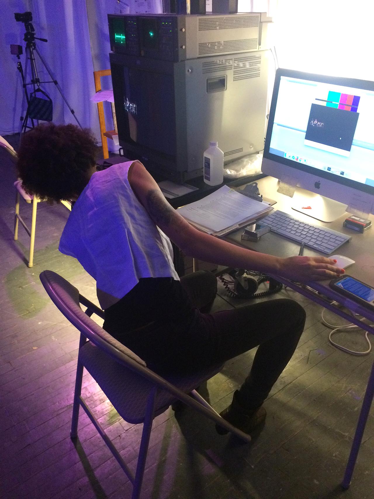 A XFR Collective member digitizing a mini DV tape