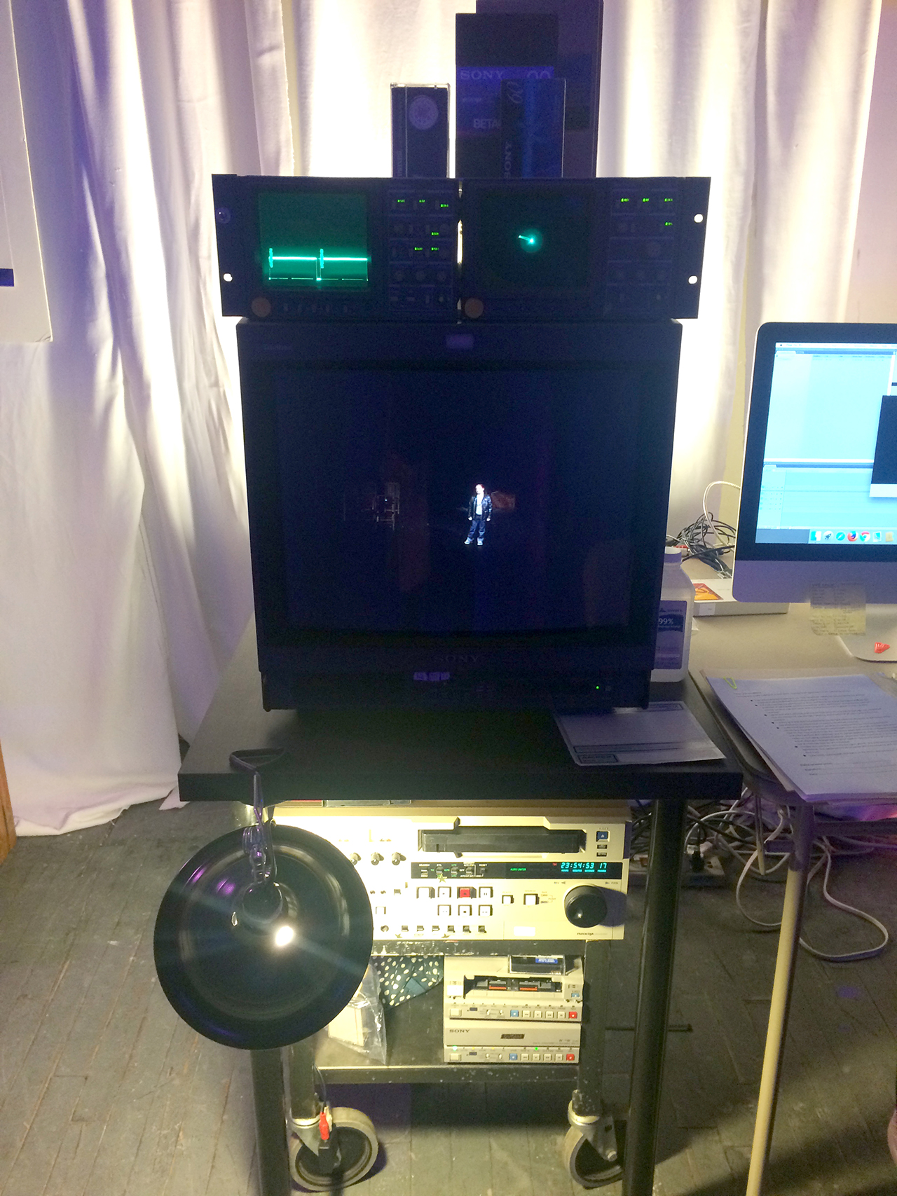 XFR Collective's rack at MIX NYC, equipped with vectorscope, wave form scope, CRT monitor, mini DV deck, and VHS deck (click to enlarge)