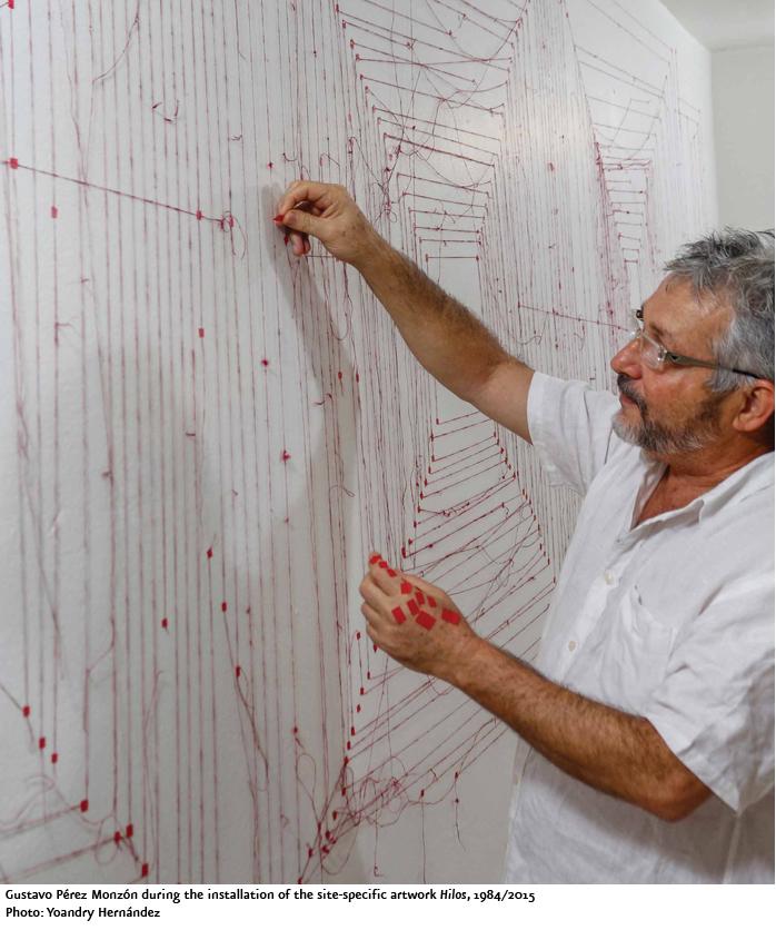 Gustavo Pérez Monzón installing a site-specific work (photo Yoandry Hernandez, via Cifo)
