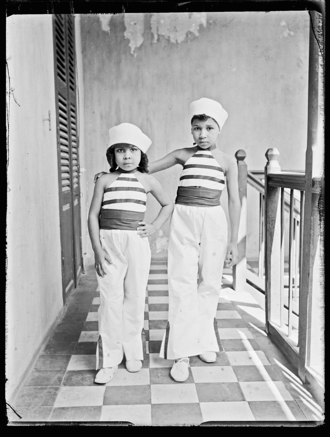 Unknown Artist (Senegal) Two Girls, Indoors, ca. 1915 Gelatin silver print from glass negative, 2015 2 x 3 in (5.7 x 7.6 cm) Visual Resource Archive, Department of the Arts of Africa, Oceania, and the Americas