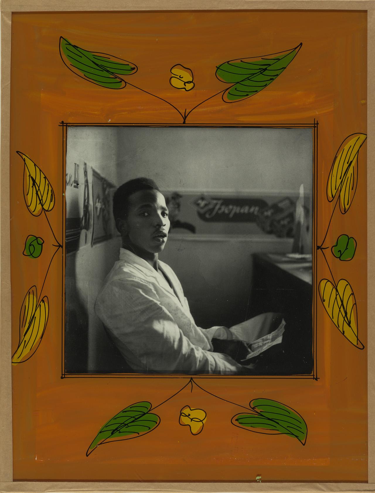Malick Sidibé (Malian, b. 1936) Self-Portrait, 1956 Gelatin silver print in original frame of reverse-painted glass, tape, cardboard, string Gift of Jack Shainman and Claude Simard, 2014 (2014.638)
