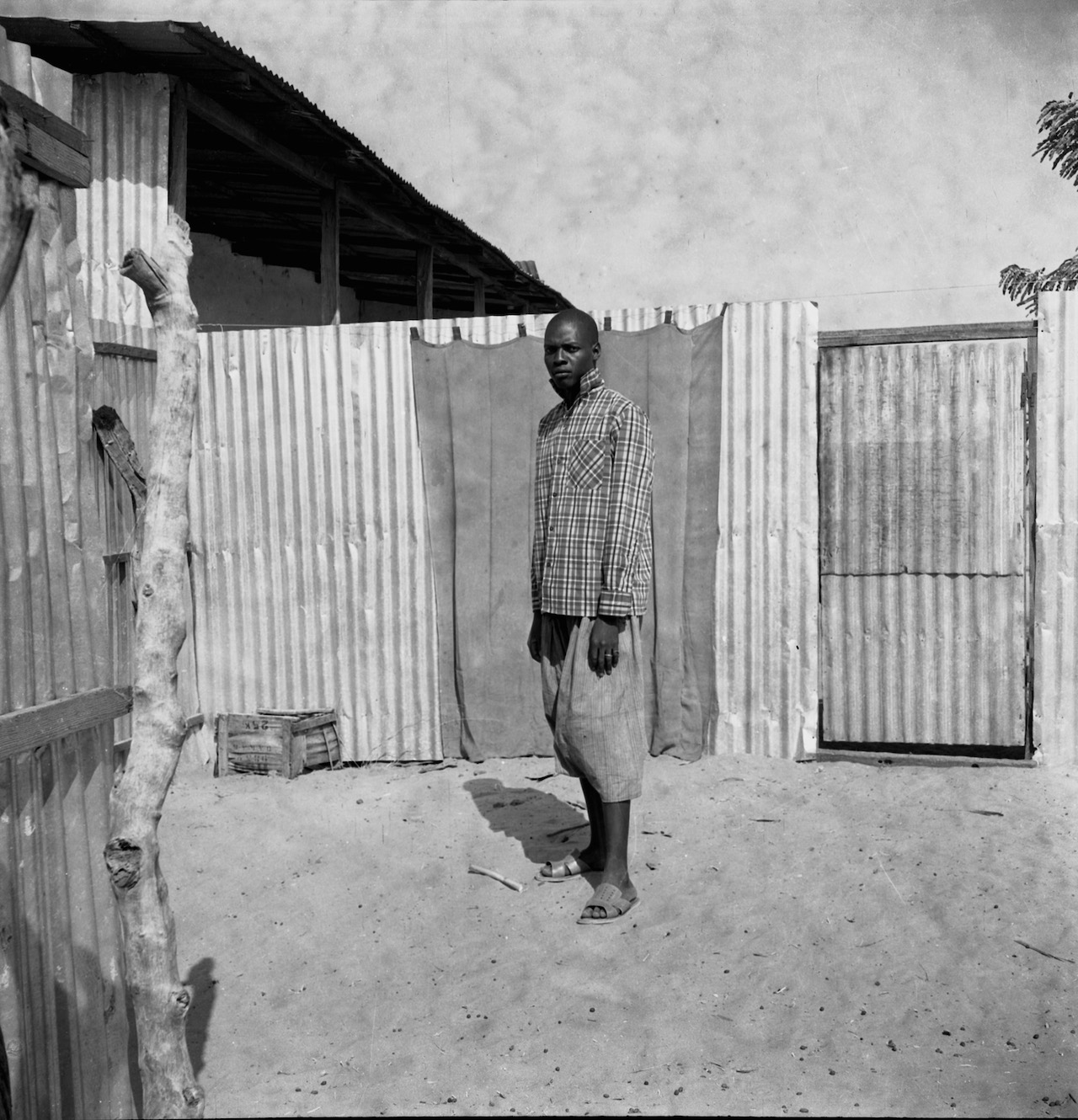 Oumar Ka (Senegalese, b. 1930) Man Standing in a Courtyard, 1959-1968 Inkjet print, 2015 Visual Resource Archive, Department of the Arts of Africa, Oceania, and the Americas