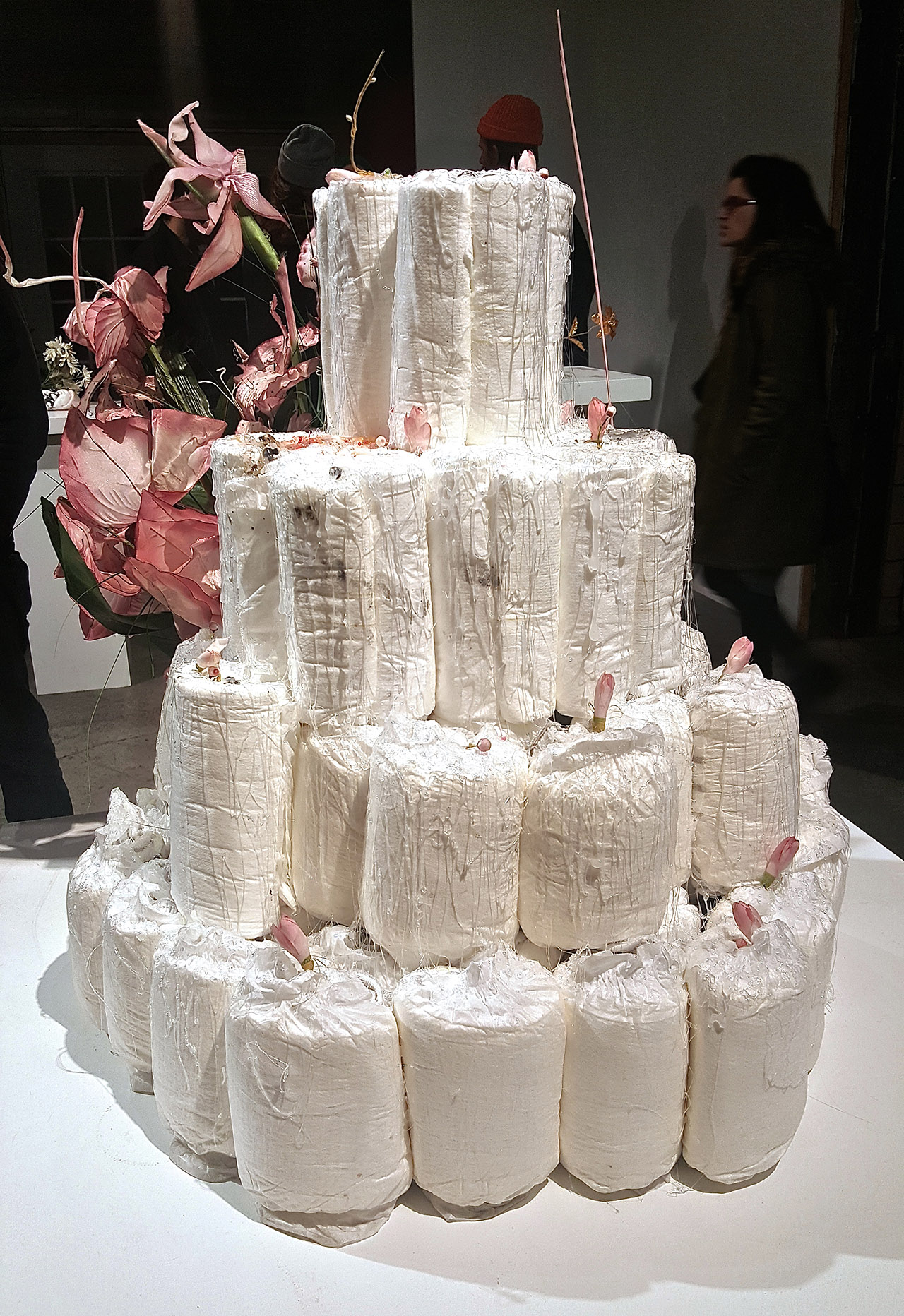 """""""Diaper Cake"""" (2015), diapers, hot glue, candies, glitter, dirt, fake flowers (click to enlarge)"""
