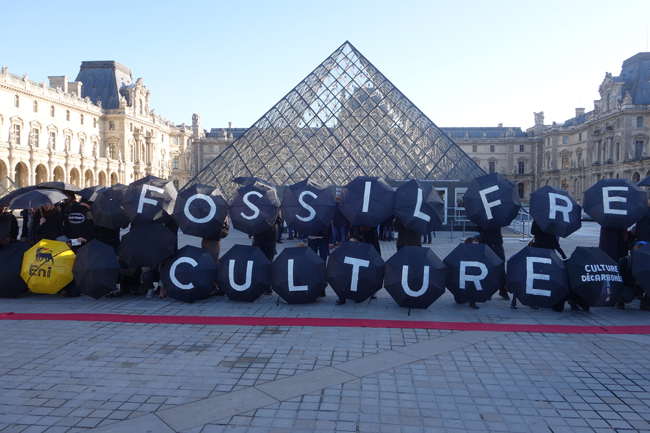 Activists in formation outside the Louvre today (all photos by the author for Hyperallergic unless otherwise noted)