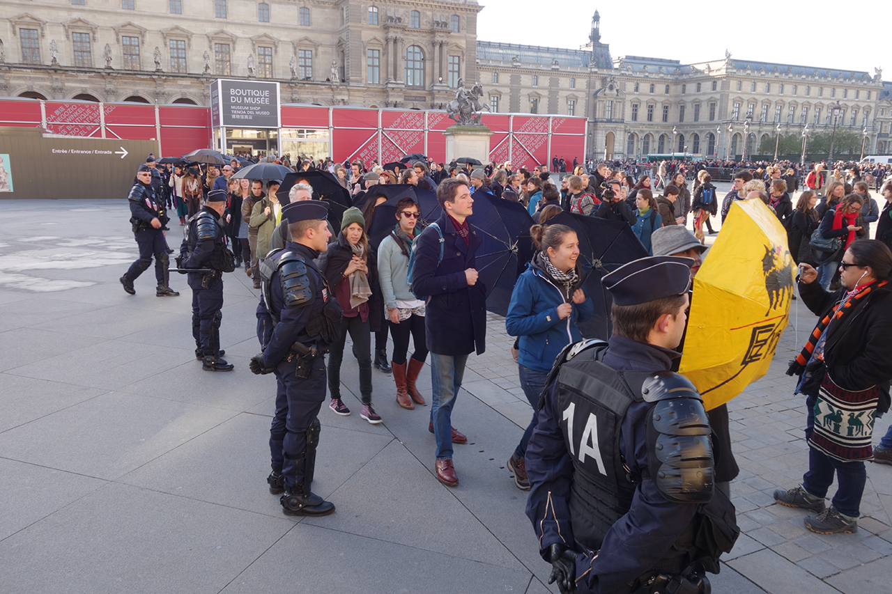 Guards and protesters in front of the Louvre