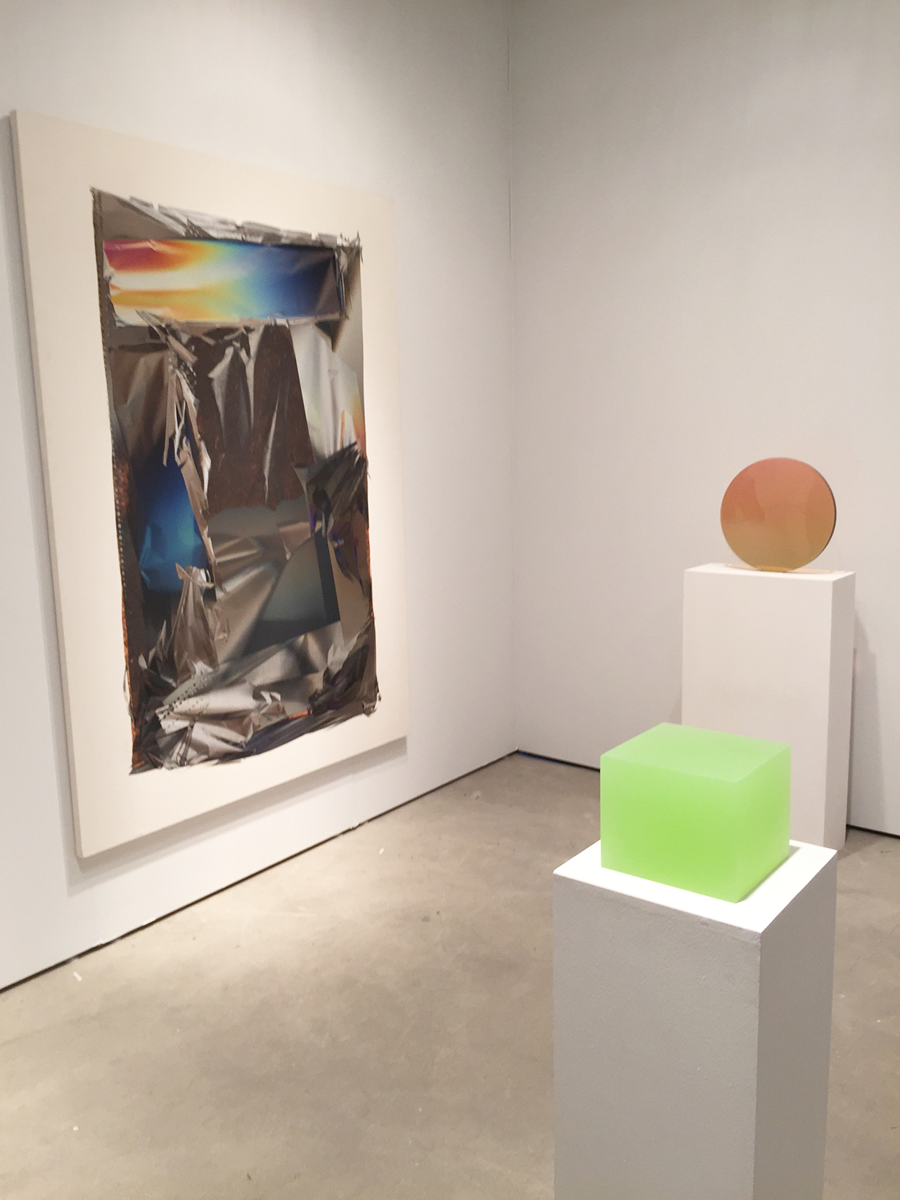 Peter Blake Gallery's booth, with work by Larry Bell at left