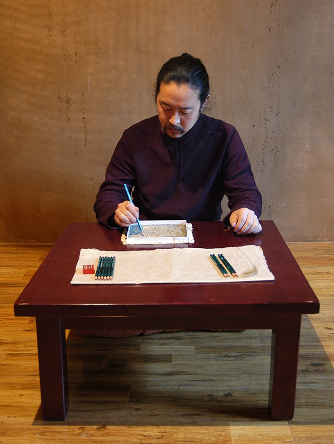 Zhou Bin performing 'Puzzling Tracks' (2014) (all images courtesy the artist)