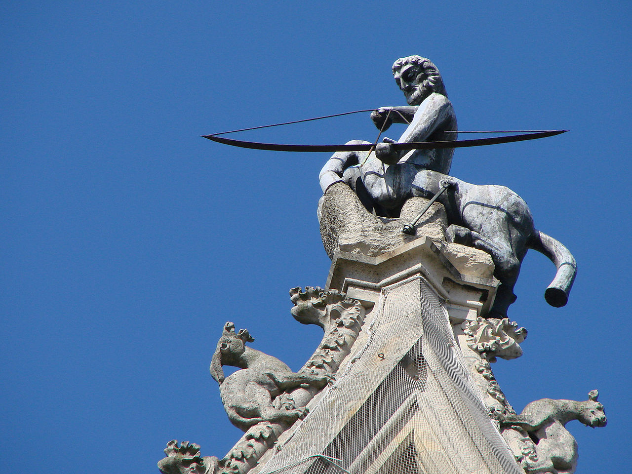 A sculpture of a Sagittarius atop the south transept of the cathedral in Reims (photo by Vassil, via Wikimedia Commons)