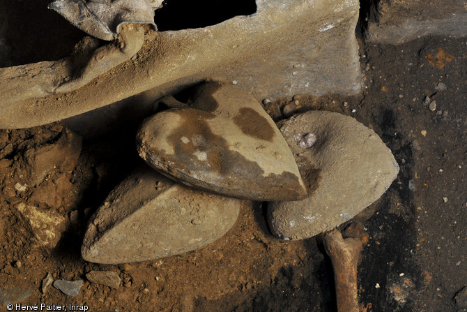 Lead heart-shaped lead urns unearthed at the excavation site (photo by Hervé Pattier)