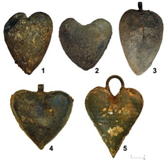 Picture of the five heart-shaped lead urns. Image by Rozenn Colleter, Ph.D./INRAP