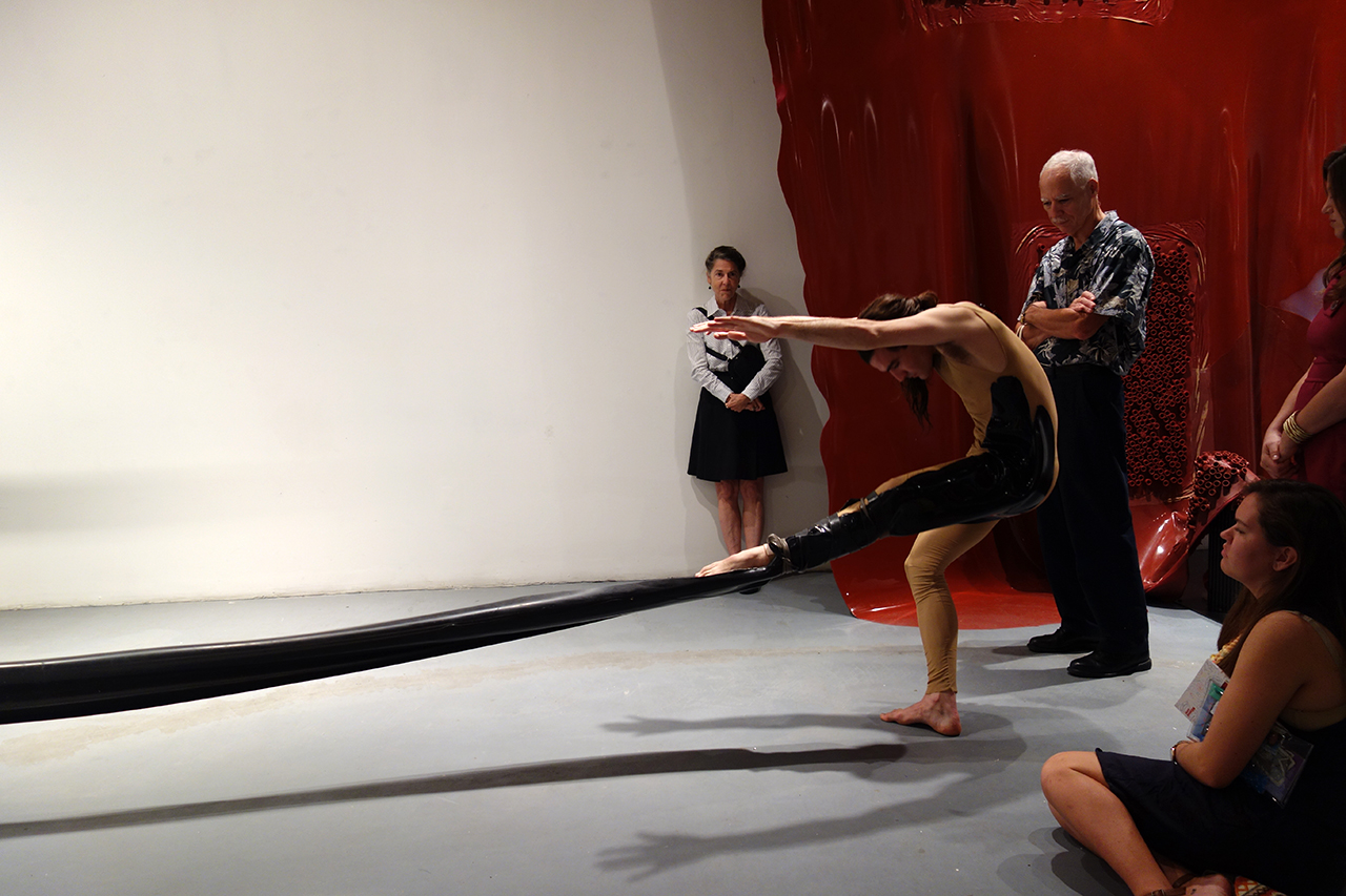 Silas Riener performing with Martha Friedman's 'Pore' at Locust Projects