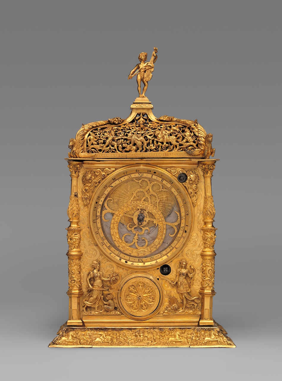Astronomical table clock Maker: Movement probably by Jeremias Metzger (German, ca. 1525–ca. 1597) Maker: Signed by Caspar Behaim (Chasparus Bohemus) (Austrian, active 1568–84) 1568 Culture: German, Augsburg Medium: Case and dials: gilded brass; Movement: iron post and frame Dimensions: Overall: 14 1/4 × 8 1/4 × 5 3/4 in. (36.2 × 21 × 14.6 cm) The Metropolitan Museum of Art, Credit Line: Gift of J. Pierpont Morgan, 1917