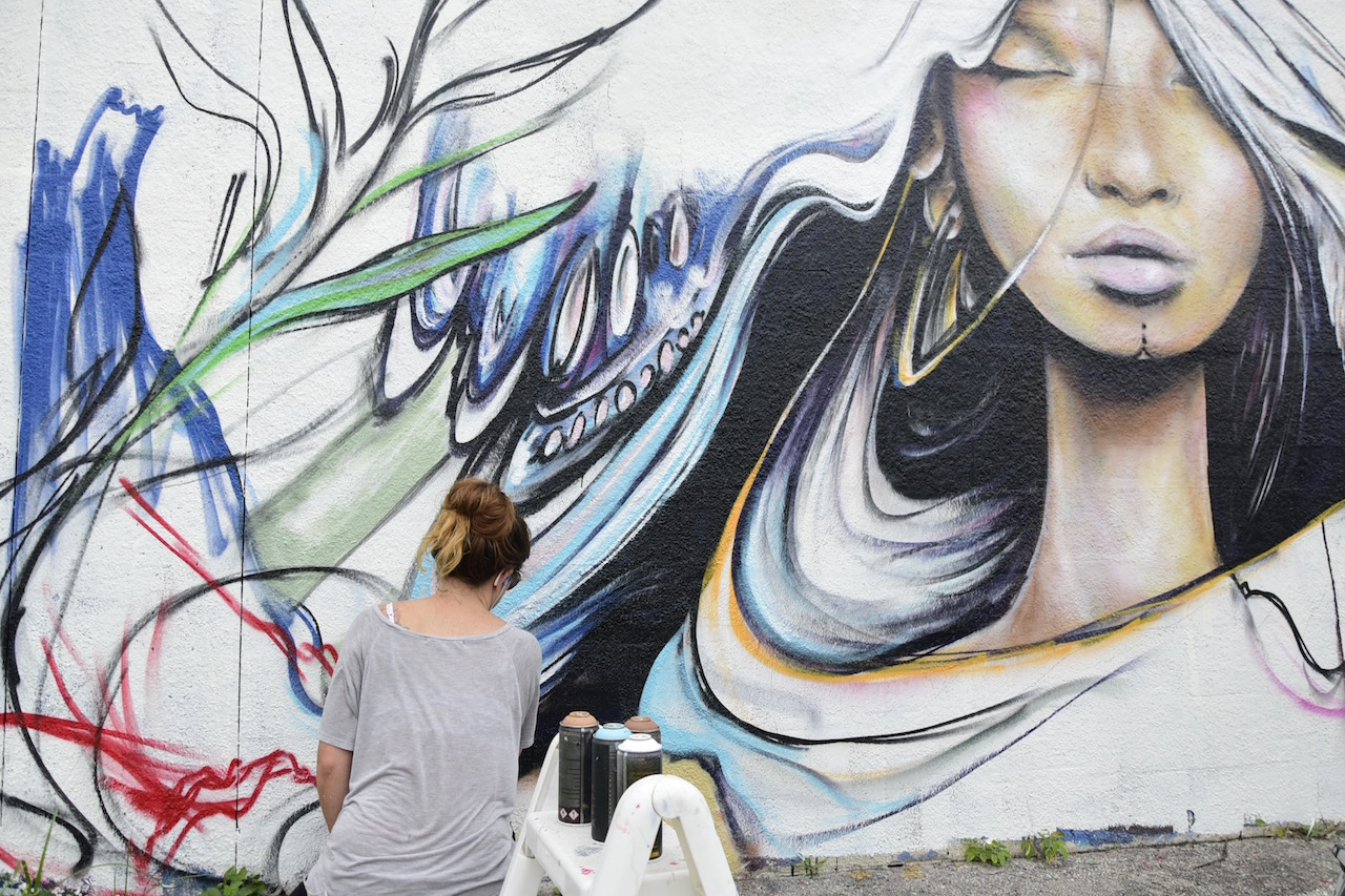 A street artist at work at the former RC Cola plant during Mana Wynwood's 'Urban Art Block Party'