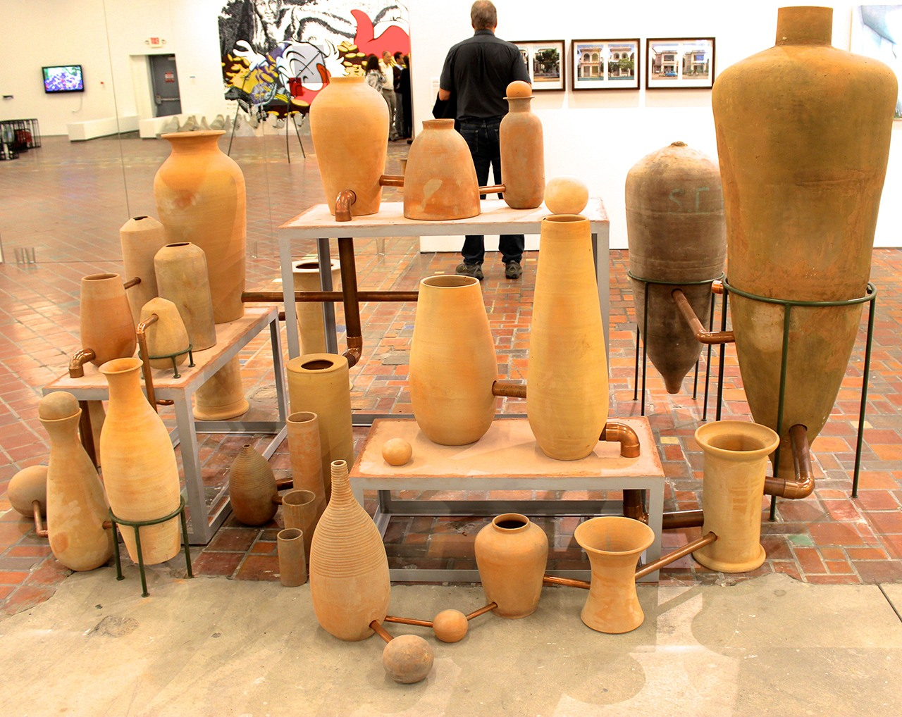 "A series of connected terra cotta pots into a kind of alchemical ""works"" by Ximeno Garrida-Lecca. (all photos by the author for Hyperallergic)"