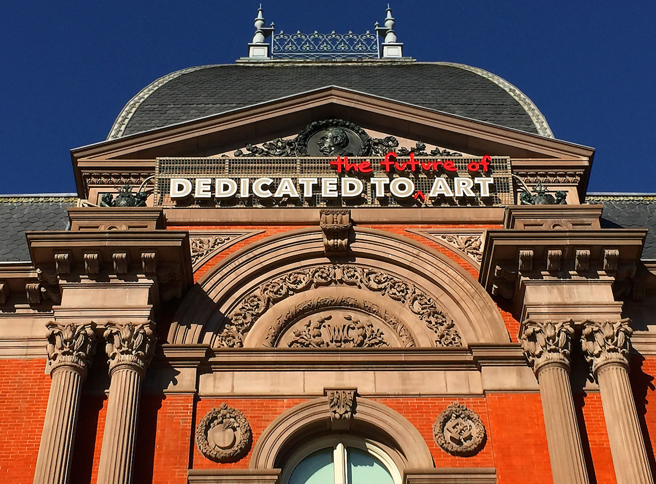 New signs on the façade of the Smithsonian's Renwick Gallery have irked preservationists. (photo by Ron Cogswell/Flickr)
