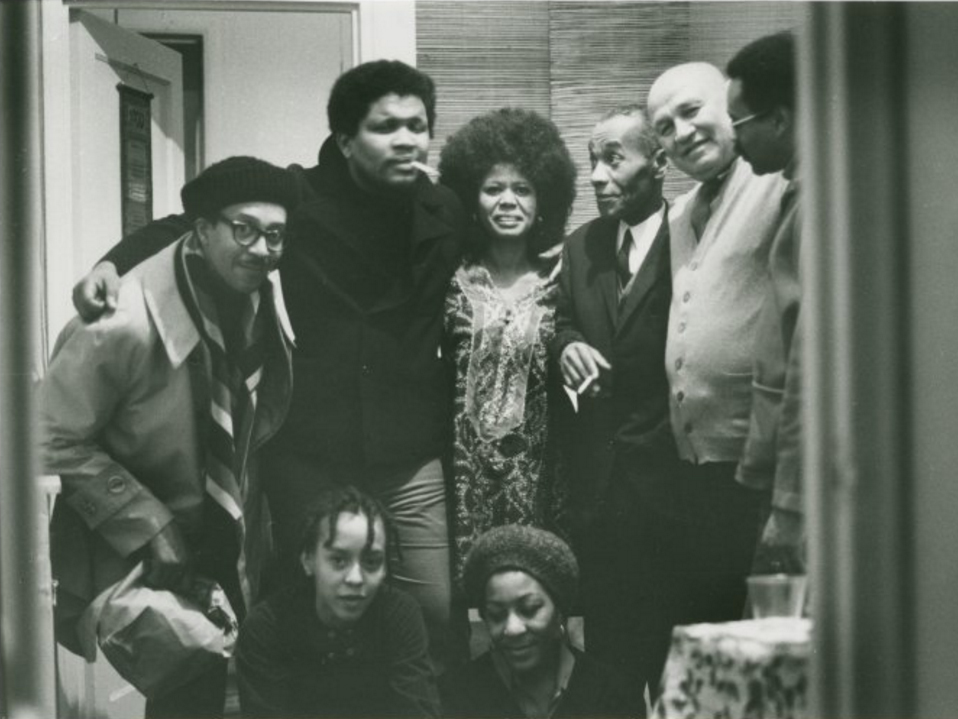 Group portrait by Melvin Edwards of (left to right): Bob Rogers, Ishmael Reed, Jayne Cortez, Léon-Gontran Damas, Romare Bearden, Larry Neal; seated: Nikki Giovanni and Evelyn Neal, in New York City, 1969 (source)