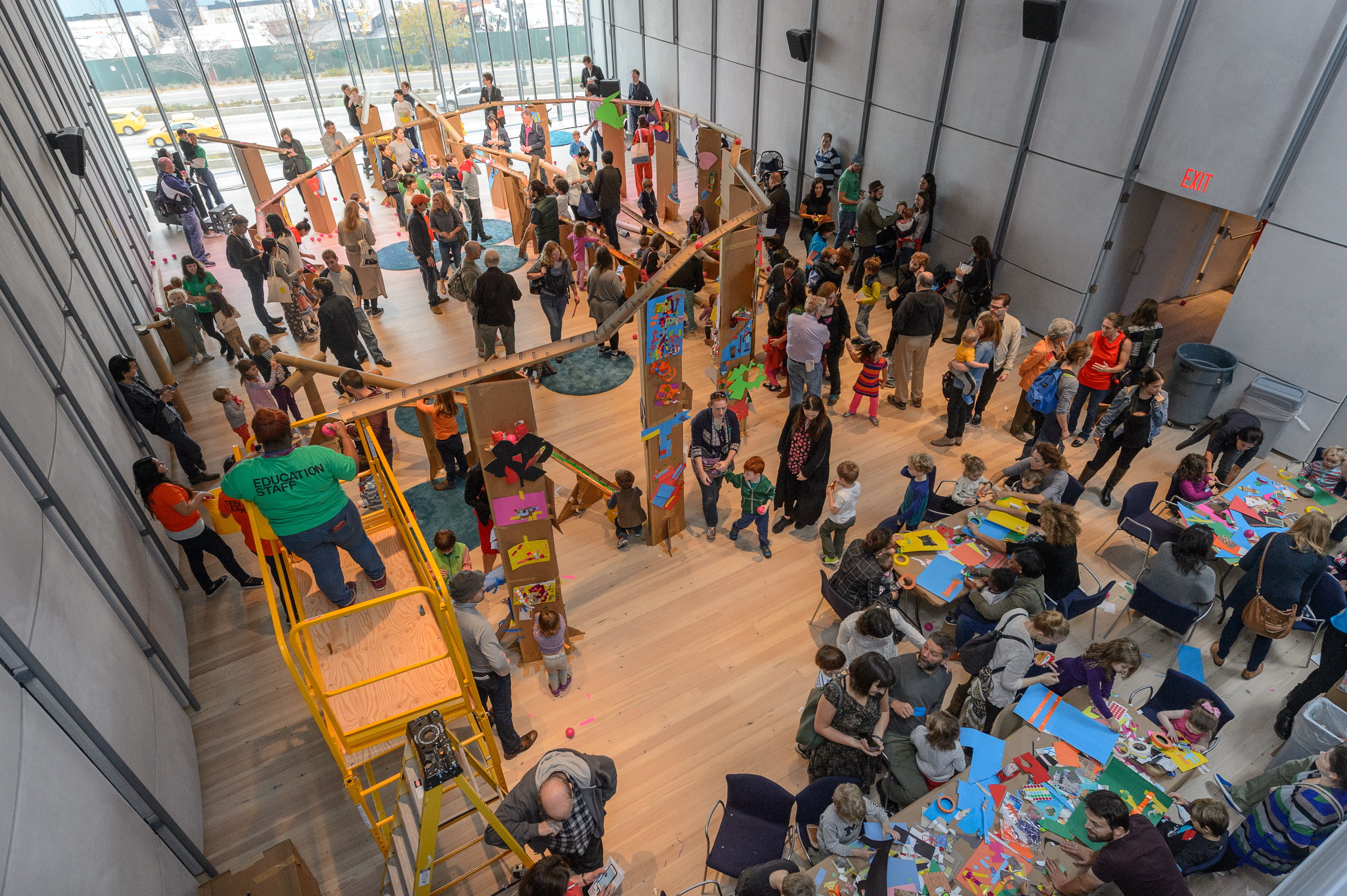 Families activate a giant marble run, designed by artist McKendree Key in the Laurie M. Tisch Education Center, 2015. Photo by Filip Wolak