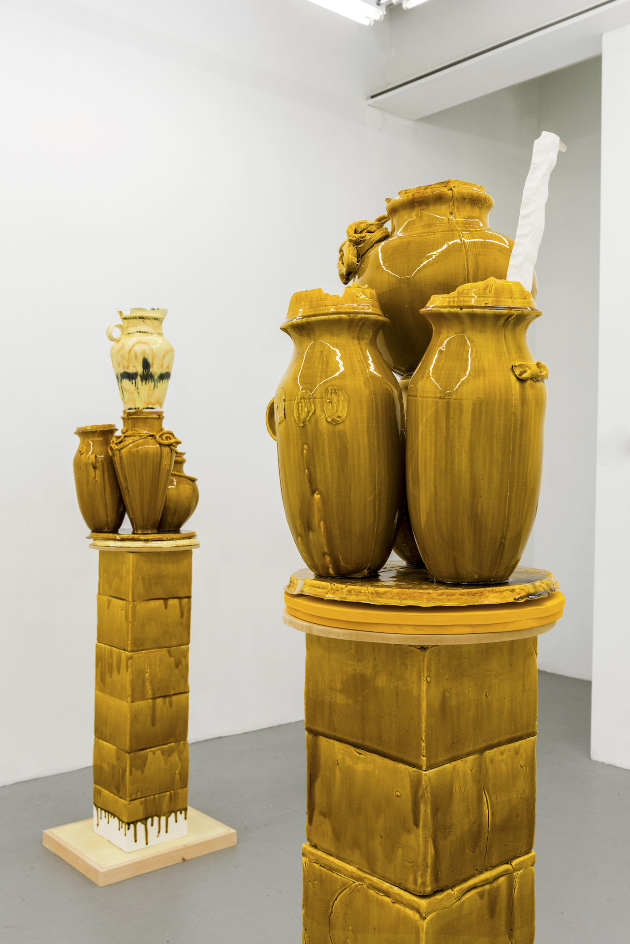 "Foreground: Nicole Cherubini ""Goldenrod"" (2015), earthenware, glaze, medium-density fiberboard (MDF), magic sculpt, 67 x 19 x 22 inches; background: Nicole Cherubini ""Althean"" (2015), earthenware, glaze, medium-density fiberboard (MDF), magic sculpt, 5 min epoxy, 75 x 19 x 22 inches (all images courtesy Samsøñ)"