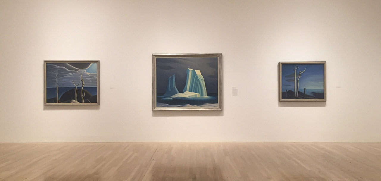 """Installation view, 'The Idea of North: The Paintings of Lawren Harris,' with """"Icebergs, Davis Strait"""" (1930) in middle (click to enlarge)"""