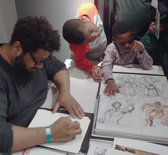 Paris Cullins draws a picture for Bryce & Josiah Adetunji