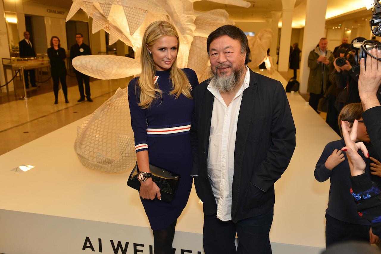 Ai Weiwei and Paris Hilton at the opening of Ai's 'Er Xi, Air de jeux' at Le Bon Marché Rive Gauche (photo © Say Who, courtesy Le Bon Marché)