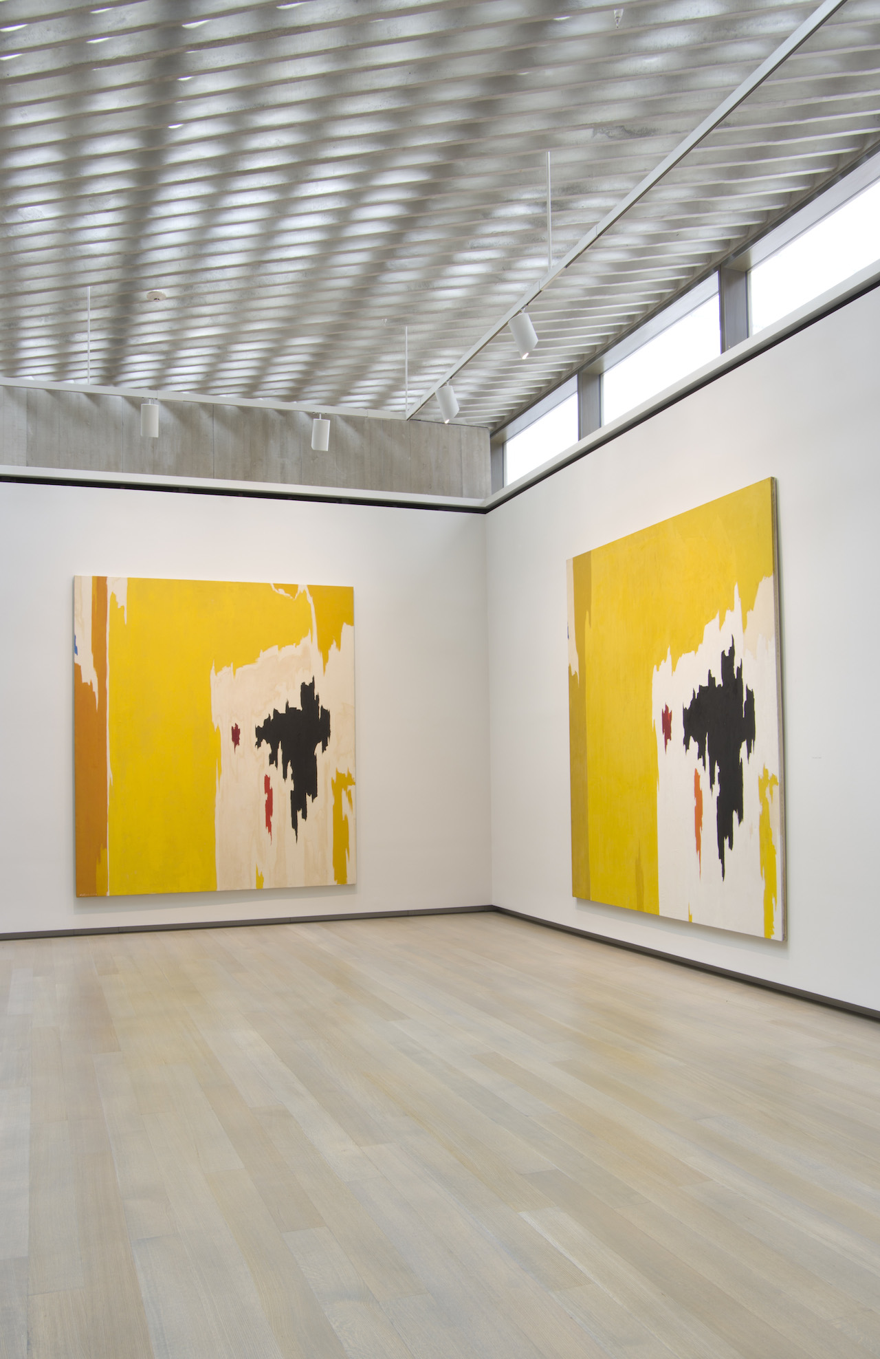 "Installation view of 'Repeat/Recreate' at the Clyfford Still Museum with ""PH-1074"" (1956–9, left, Clyfford Still Museum © City and County of Denver) and ""PH-225"" (1956, right, collection of the Modern Art Museum of Fort Worth, Museum purchase, The Benjamin J. Tillar Memorial Trust © City and County of Denver)"