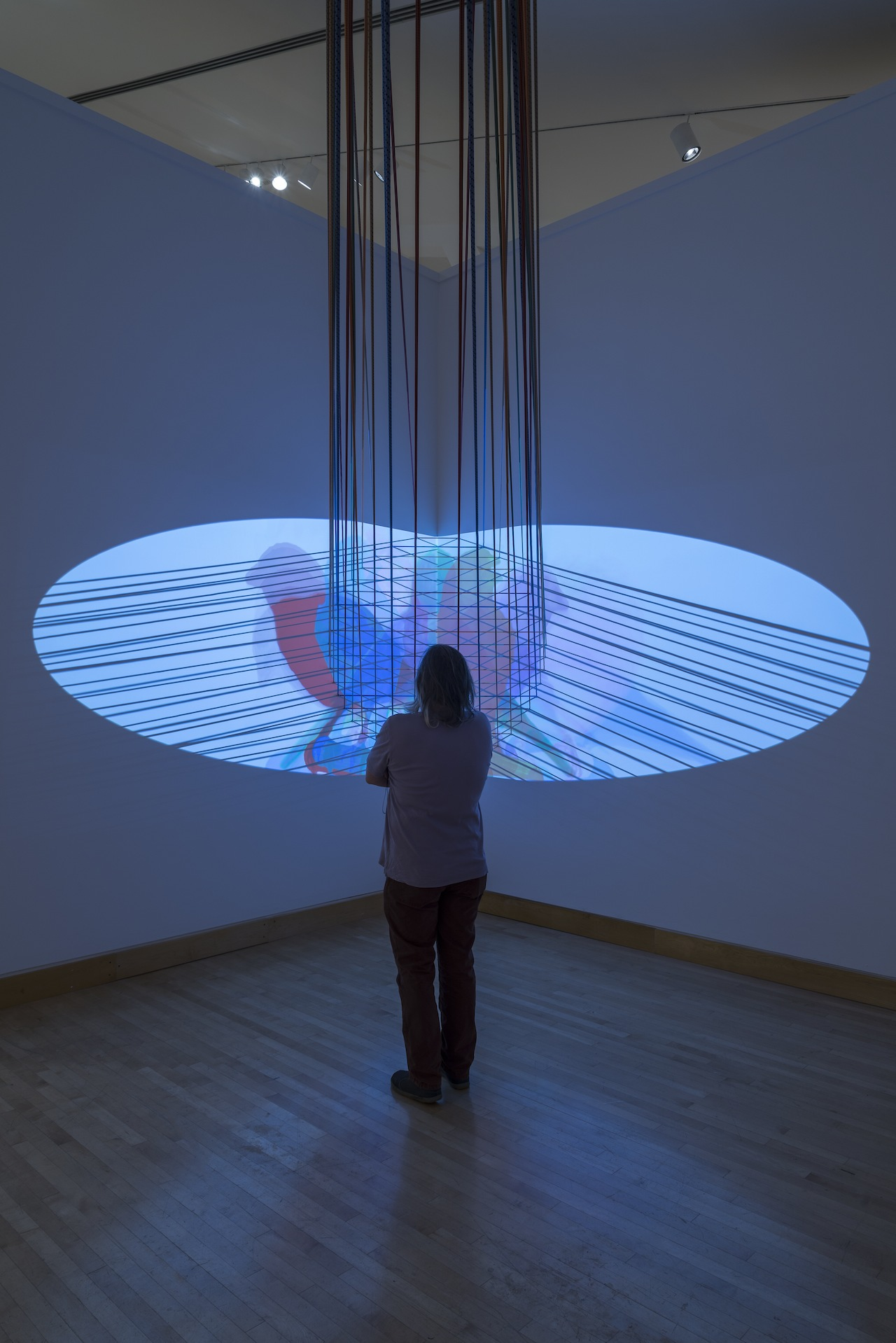 """Installation view of Vesa-Pekka Rannikko, """"Canary"""" (2013), two-channel HD video installation, climbing ropes, carabiners, dimensions variable, five-minute loop (photo by E.G. Schempf, courtesy the Kemper Museum of Contemporary Art)"""