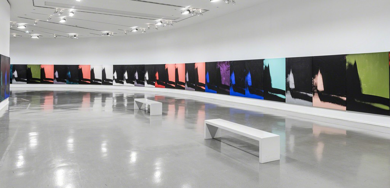 """Installation view of 'Warhol Unlimited' with selections from Andy Warhol's """"Shadows"""" (1978–79) (photo by Pierre Antoine, courtesy the Musée d'art moderne de la Ville de Paris"""