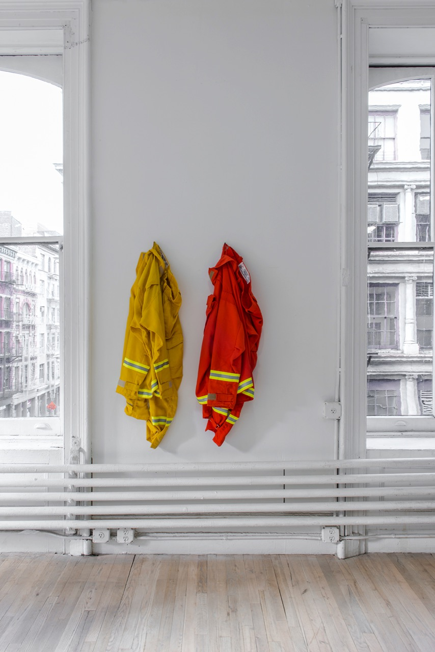 """1st Defense NFPA 1977, 2011, 2016 Nomex fire suit, distributed by CALPIA 50  13  8 inches Rental at cost """"The Department of Corrections shall require of every able-bodied prisoner imprisoned in any state prison as many hours of faithful labor in each day and every day during his or her term of imprisonment as shall be prescribed by the rules and regulations of the Director of Corrections."""" – California Penal Code § 2700 CC35933 is the customer number assigned to the nonprofit organization California College of the Arts upon registering with the CALPIA, the market name for the California Department of Corrections and Rehabilitation, Prison Industry Authority. Inmates working for CALPIA produce orange Nomex fire suits for the state's 4300 inmate wildland firefighters. Courtesy of the artist and ESSEX STREET, New York Photo: Adam Reich"""