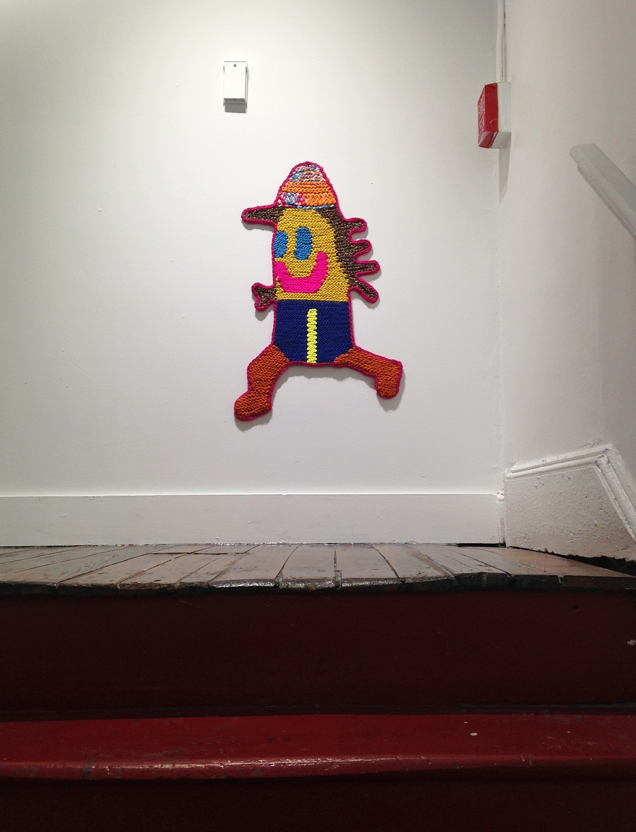 """Caroline Wells Chandler's """"Zack"""" (2016), hand-crocheted assorted wool, 30"""" x 22"""", installed at Lord Ludd (all photos by the author for Hyperallergic unless otherwise noted)"""