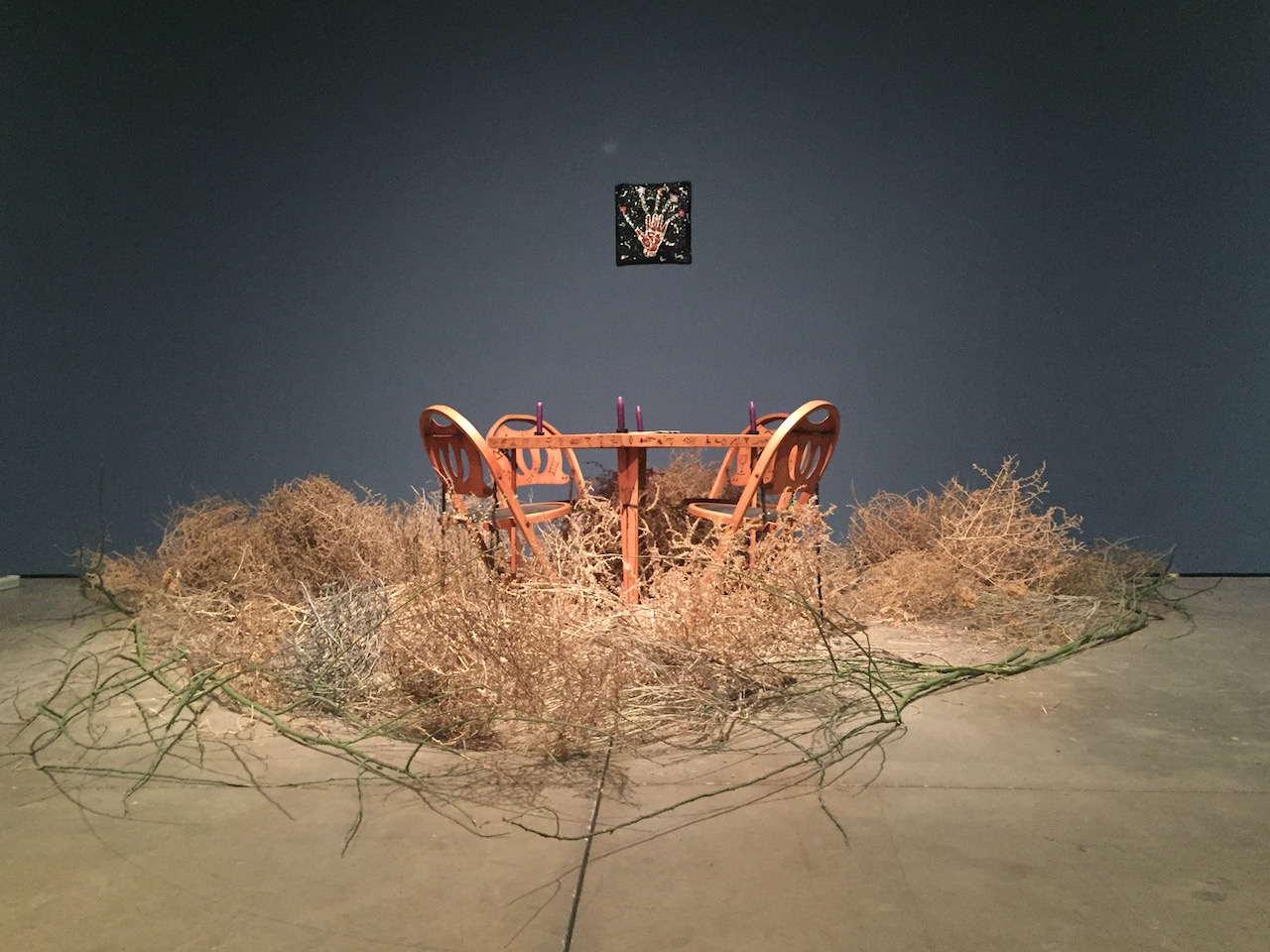 """Installation view, Betye Saar, """"House of Fortune"""" (1988), table and four chairs, table 27""""H x 30"""" x 30"""", four chairs, each 39"""" x 17-1/4"""" x 16"""""""