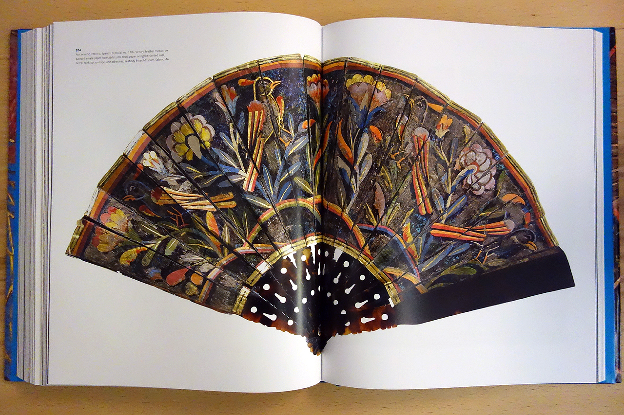 Pages from 'Images Take Flight: Feather Art in Mexico and Europe' (photo of the book for Hyperallergic)