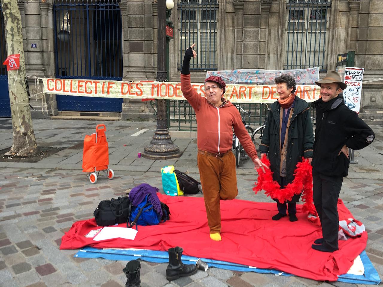 Members of the Collectif des Modèles d'Art de Paris demonstrate in the Place de l'Hôtel de Ville.