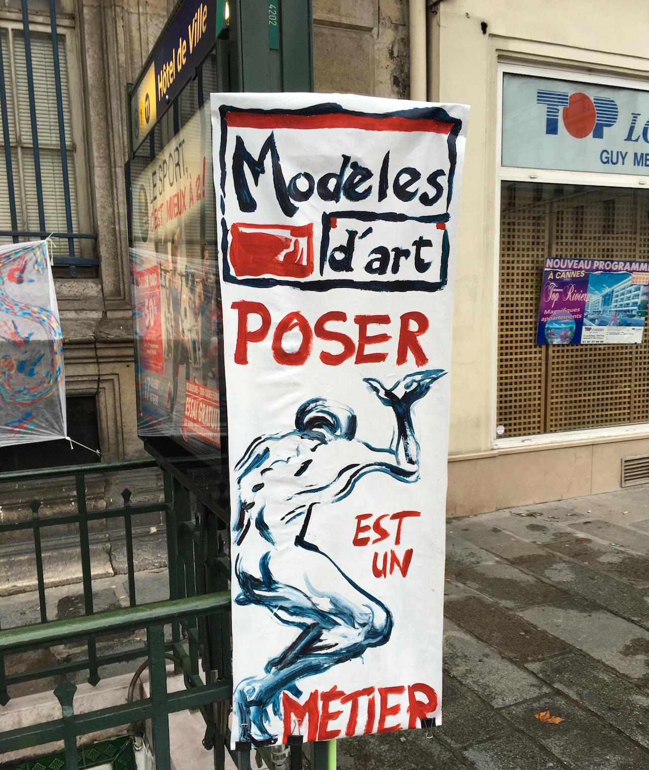 A Collectif des Modèles d'Art de Paris sign at Saturday's protest