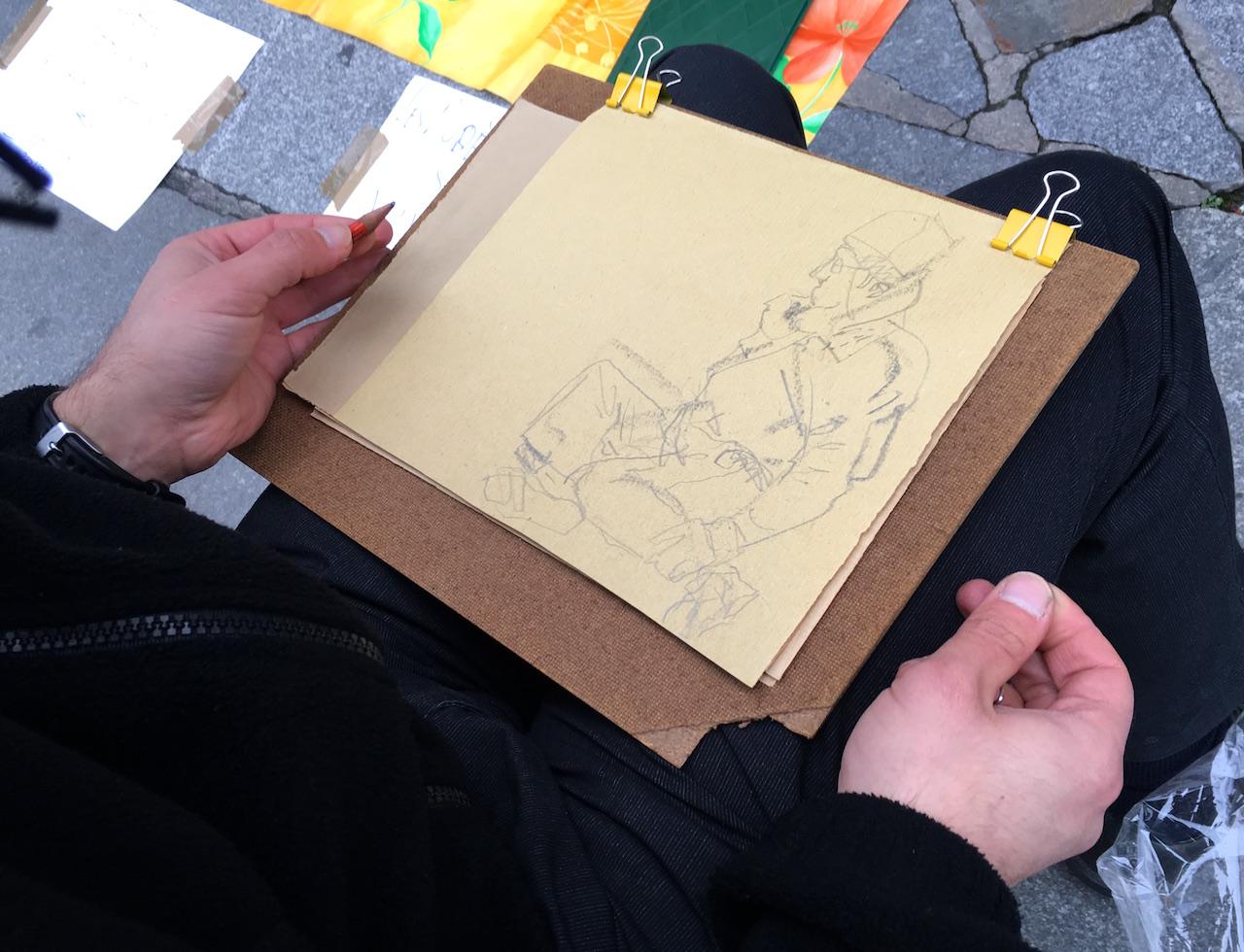 Members of the Collectif des Modèles d'Art de Paris stage a life drawing session in the Place de l'Hôtel de Ville.