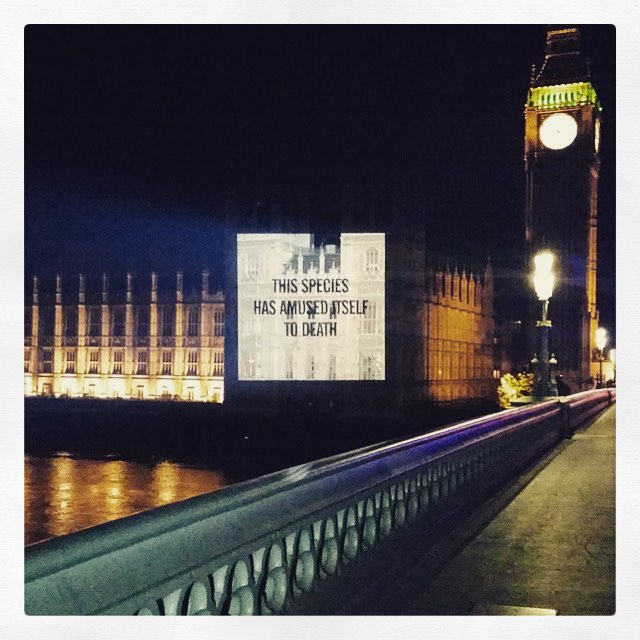 Album art for 'Amused to Death' projected on Houses of Parliament (image via @sarahmcgiven/Instagram)