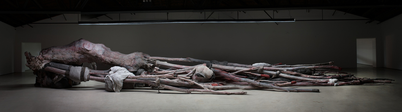 "Berlinde De Bruyckere, ""Kreupelhout - Cripplewood"" (2012–13), wax, epoxy, iron, wood, fabric, blankets, and rope (photo by Mirjam Devriendt)"