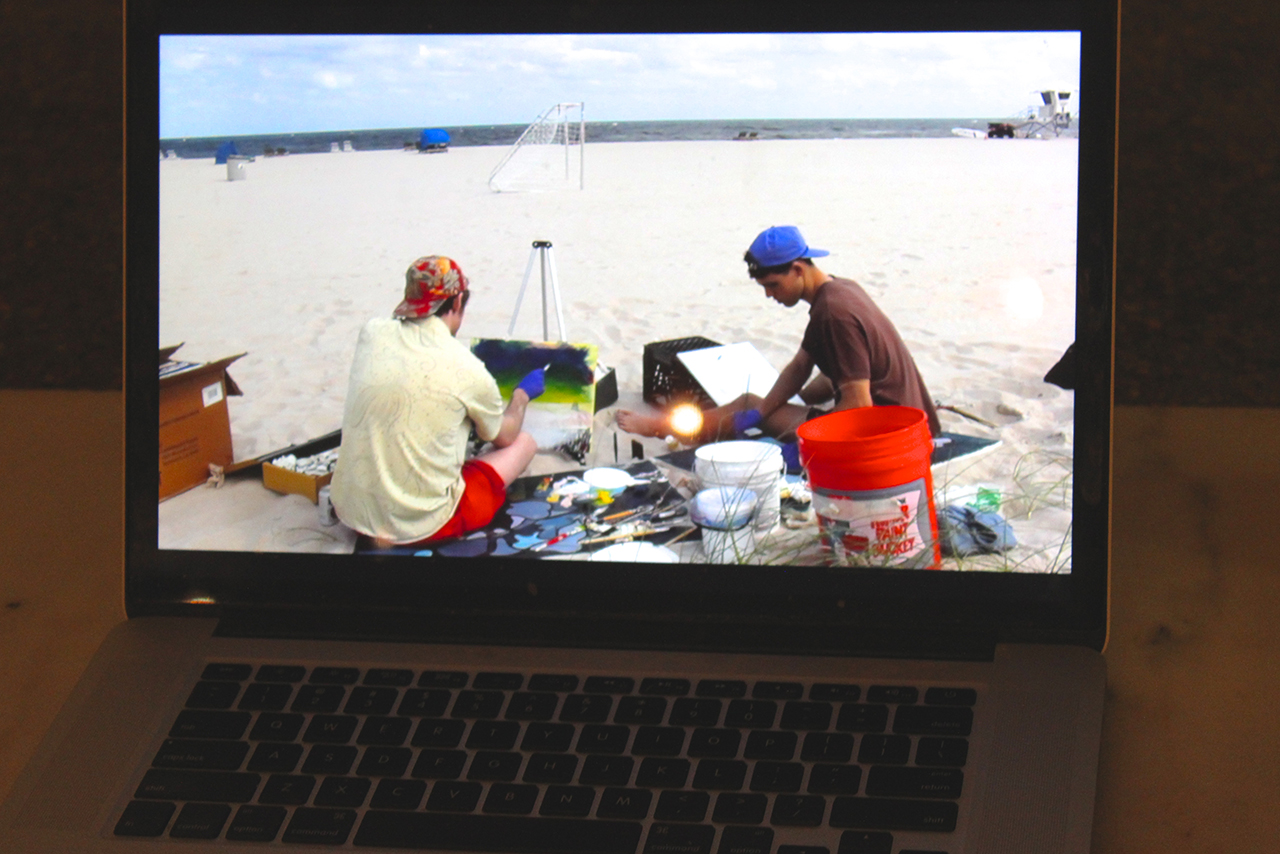 Crissman and Poe painting by on the Florida seashore (video on display at Trinosophes)