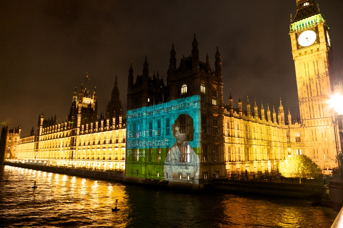 An image of the Mary Wollstonecraft Project, projected onto the Houses of Parliament (photo by Neil Wissink via Wikipedia)