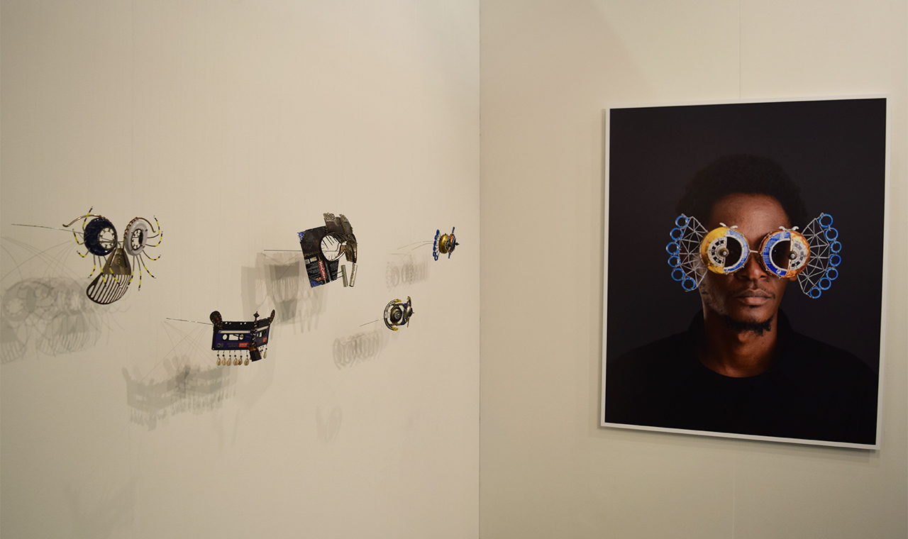 Sculptures and a photograph by Cyrus Kabiru in the SMAC Gallery booth at the 2016 Armory Show