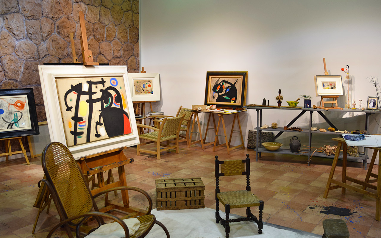 """Installation view of 'Miró's Studio' in the Mayoral booth, with Joan Míro's """"Women V"""" (1969) on the left, at the 2016 Armory Show"""