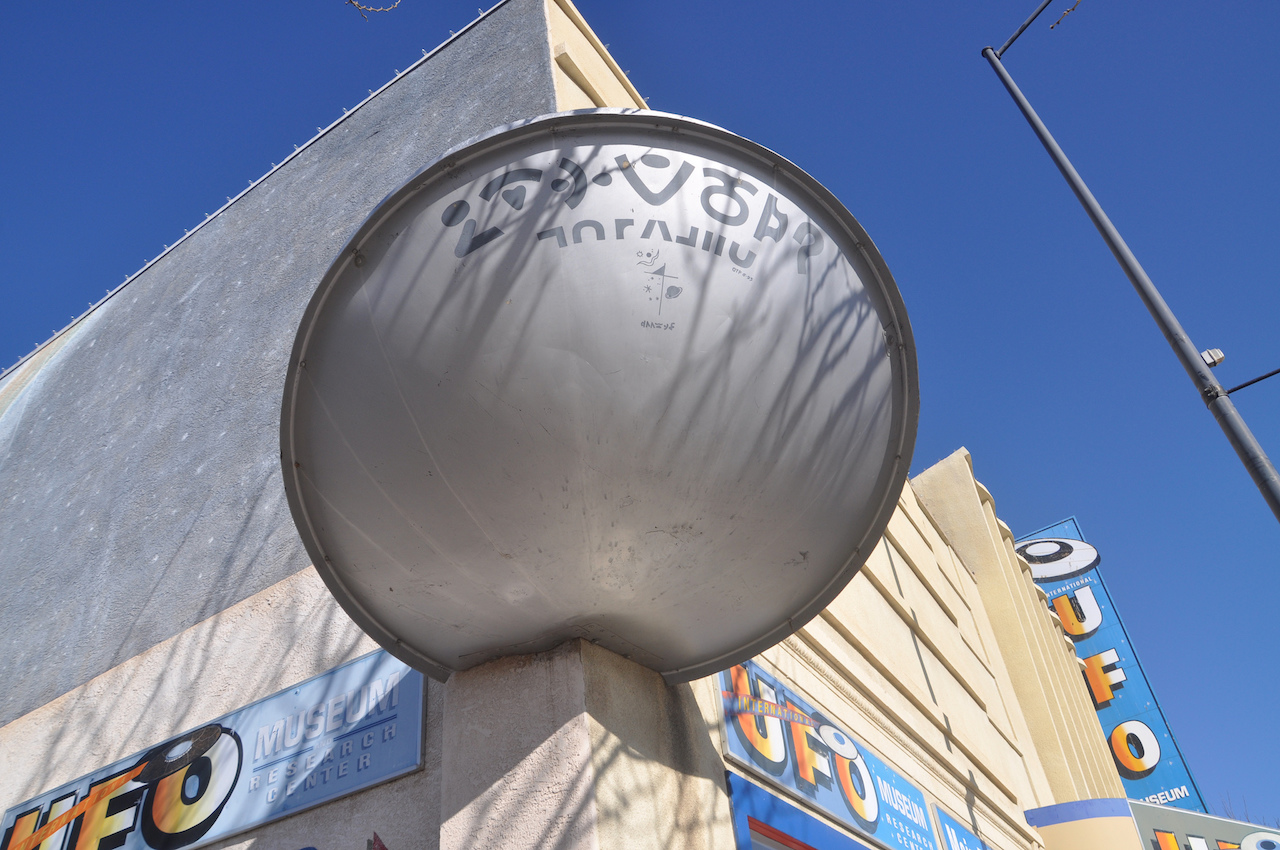 This flying saucer sculpture on the exterior of the International UFO Museum and Research Center was recently stolen and smashed. (photo by Tiffany LeMaistre/Flickr)