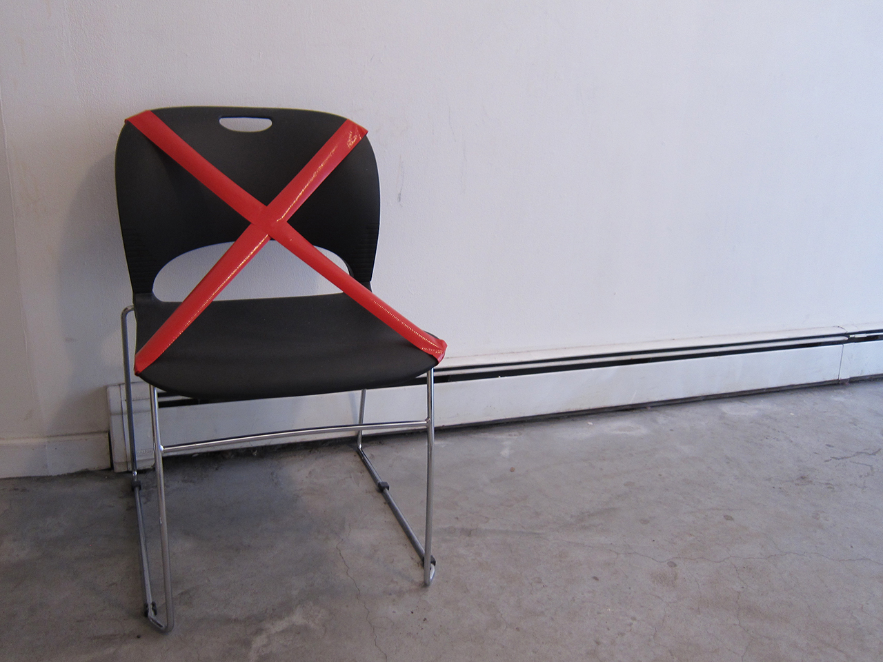 An empty chair to represent and honor those unable to participate in conversations at FIREWALL