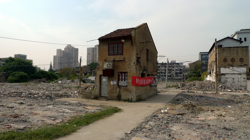 """A """"nail house"""" in the Hongkou District of Shanghai, China (photo by Drew Bates/Flickr)"""