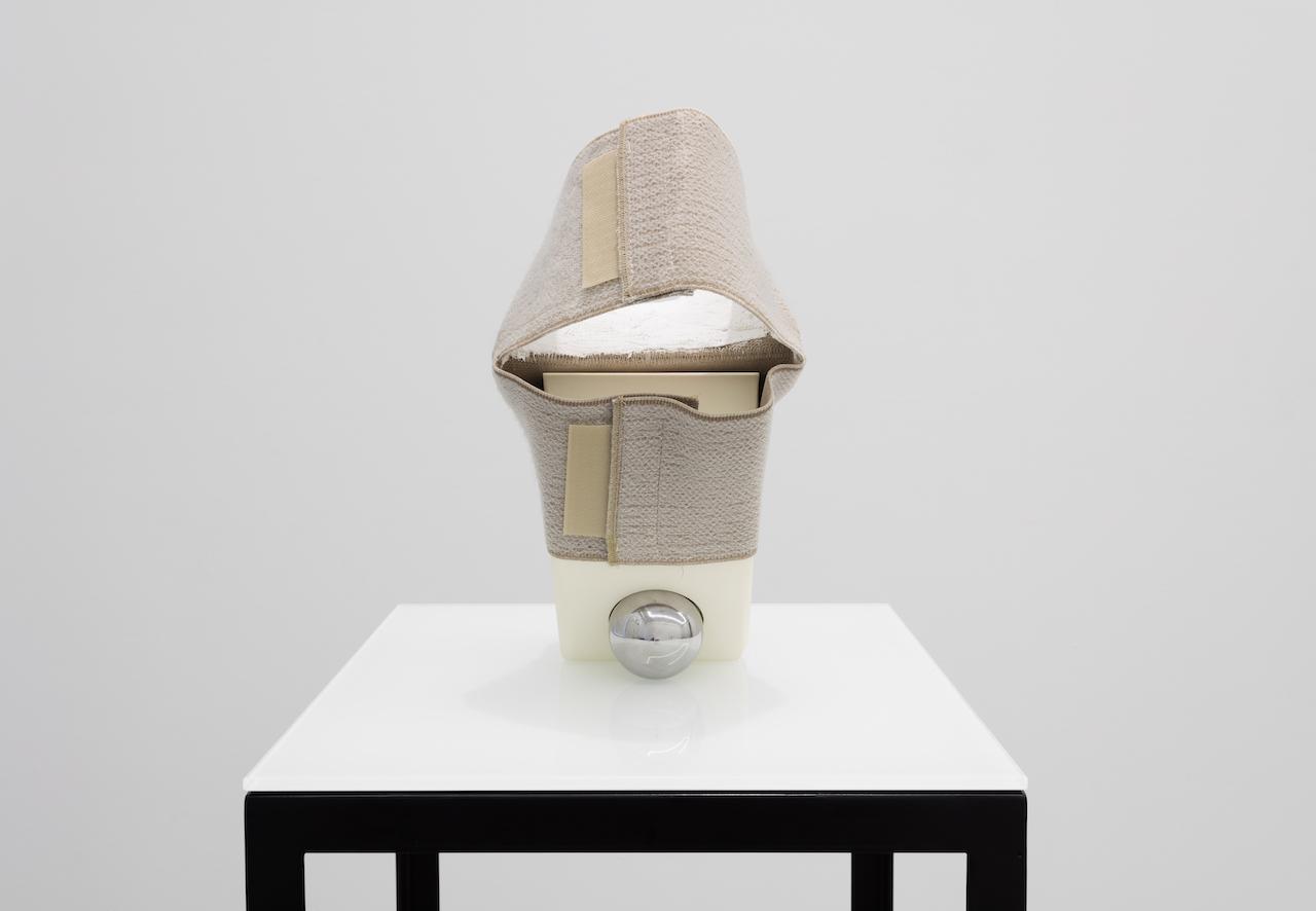"Ross Knight, ""Precision Bearing (...) Brace"" (2015), urethane, chrome steel, knee brace, plaster glaze, 11.5 x 6 x 9 in"