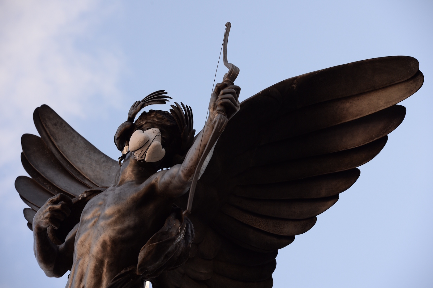 The Eros statue in Piccadilly Circus with an emergency face mask (photo by Chris Ratcliffe)