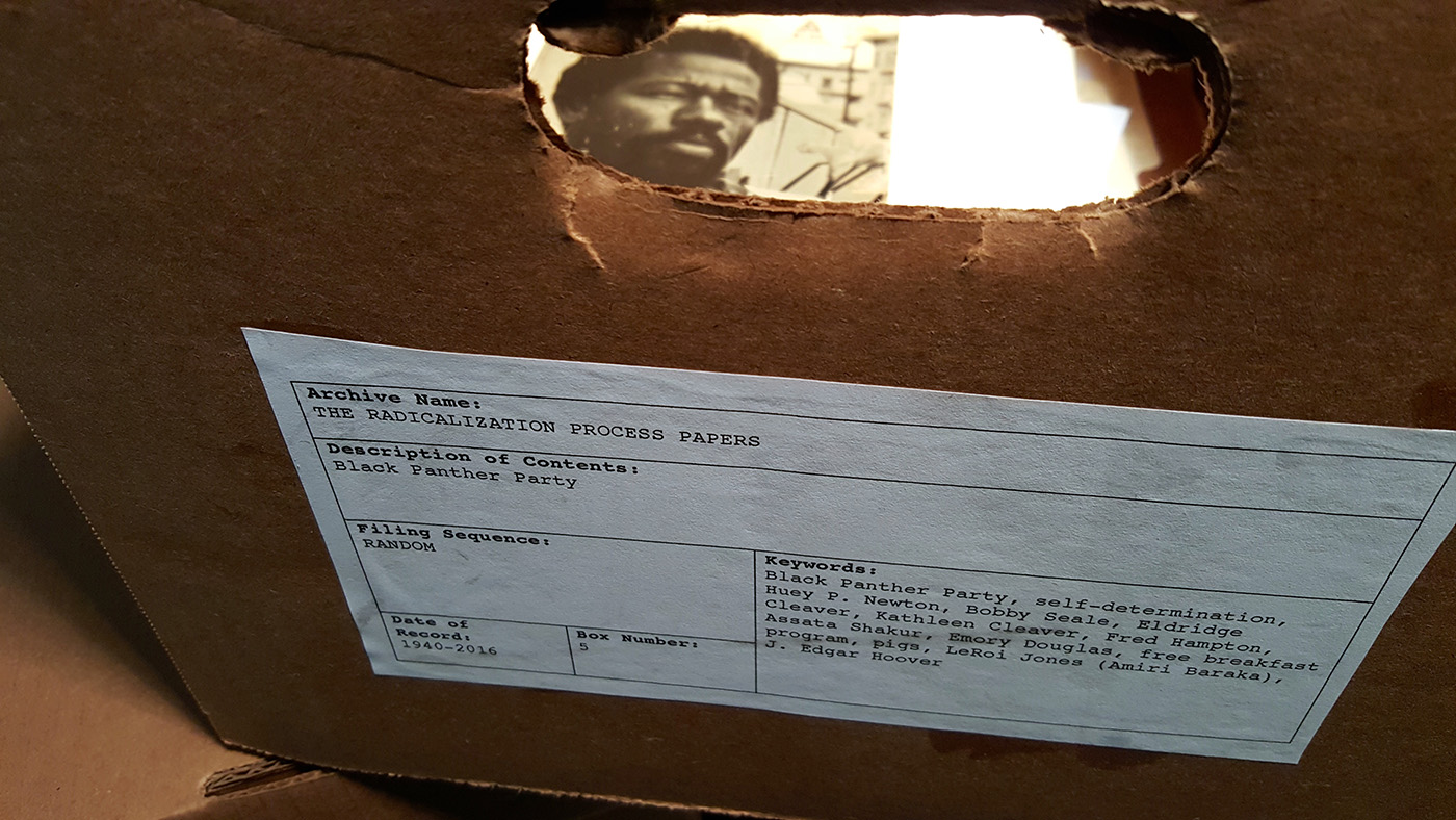 Items within the basement archive, largely constructed by poet and Black Panther Movement scholar Casey Rocheteau http://caseyrocheteau.org/ (photo by the author for Hyperallergic)