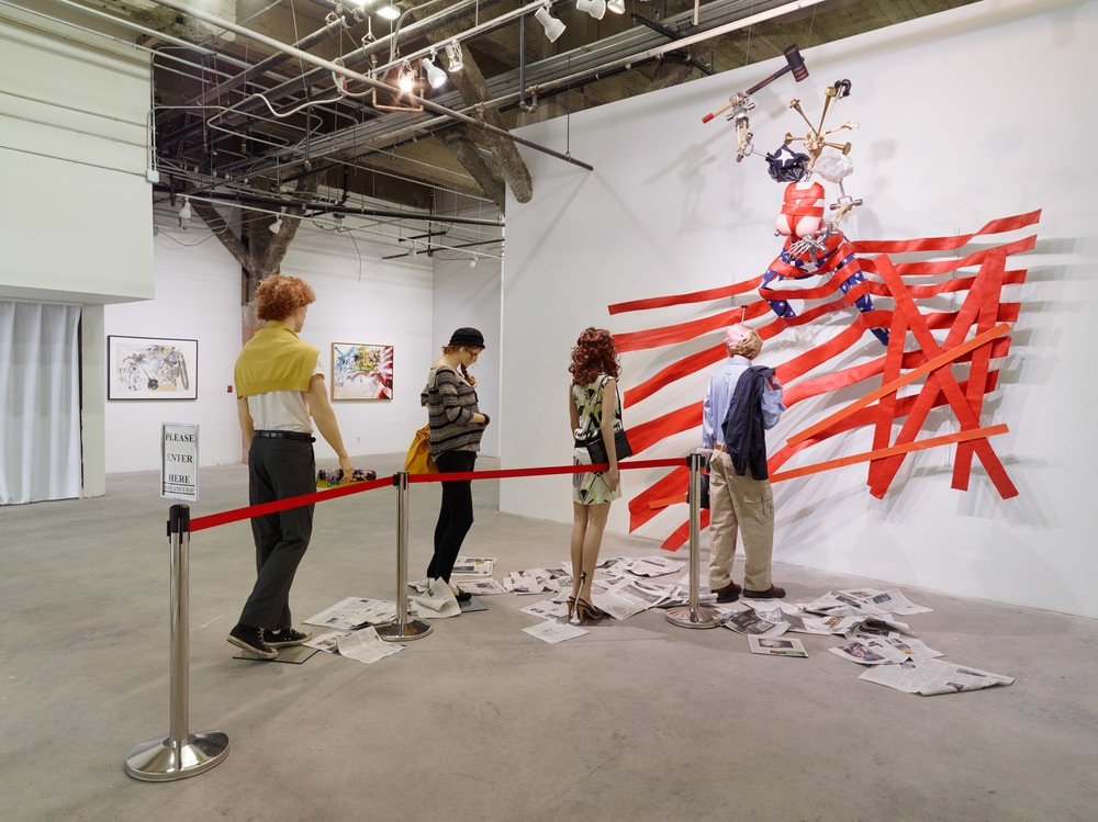 """Ed Bereal, """"Miss America: Manufacturing Consent (Upside down and backwards)"""" (2000-2015), Mixed Media, 10' x 12 1/2' x 16' (via harmonymurphygallery.com)"""